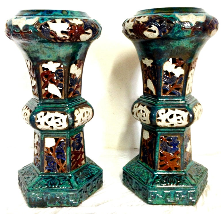 Contemporary pair of ceramic glaze Chinese Export garden pedestals. Executed in a