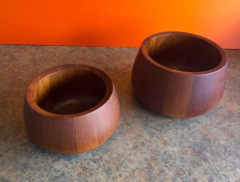 A very nice pair of staved teak serving bowls by Jens Quistgaard for Dansk, circa 1960's. The larger bowl measures 10.5