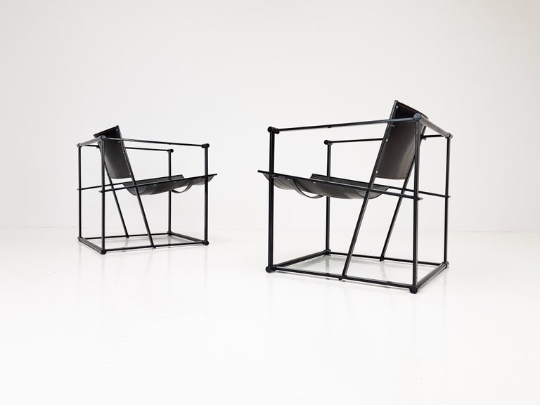 A pair of steel and leather FM62 chairs by Radboud Van Beekum for Pastoe, 1980s.  Constructed from geometrically folded steel with bent ply seating. Inspired by the designs of Gerrit Rietveld and following the traditions of the De Stijl movement the