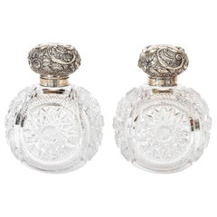 Pair of Sterling Silver and Cut Glass Cologne Bottles