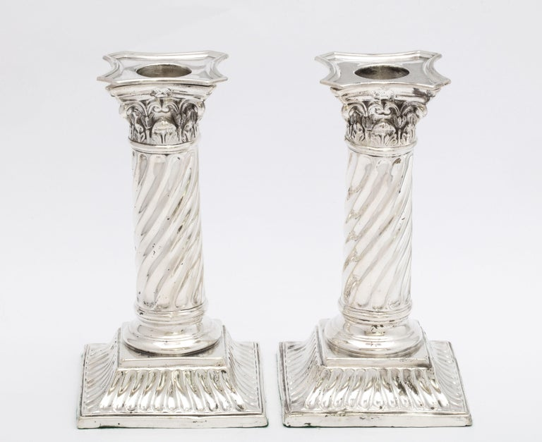 Pair of sterling silver, neoclassical, Corinthian column candlesticks with swirled columns, London, 1890, Richard Martin and Ebenezer Hall - makers. Each measures 6 inches high x 3 inches wide x 3 inches deep. Weighted. Bobeches are removable. Minor