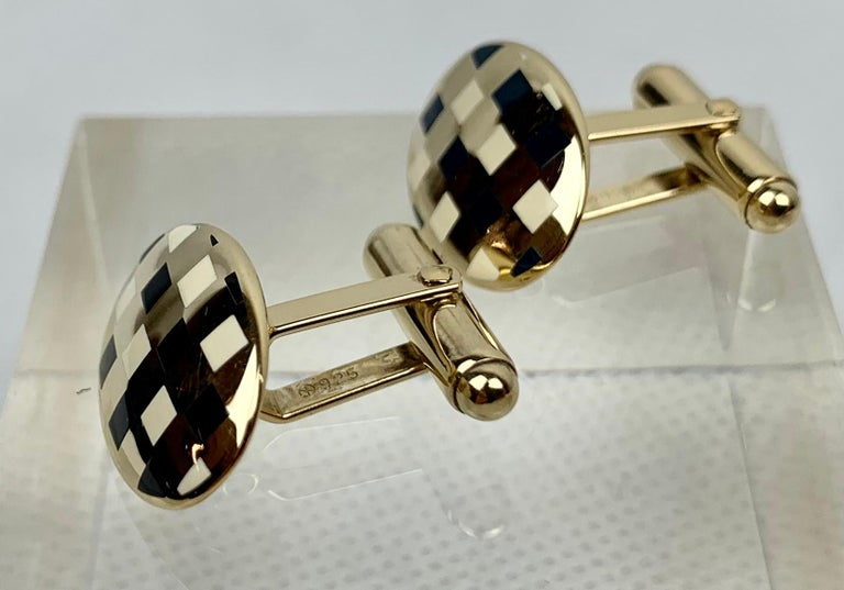 Pair of sterling silver (vermeil) oval cufflinks with squares of black and white enamel.  They are marked sterling and .925 on the post.  The posts are hinged so they can move with your shirt as your wrist bends.  Better cufflinks were always made