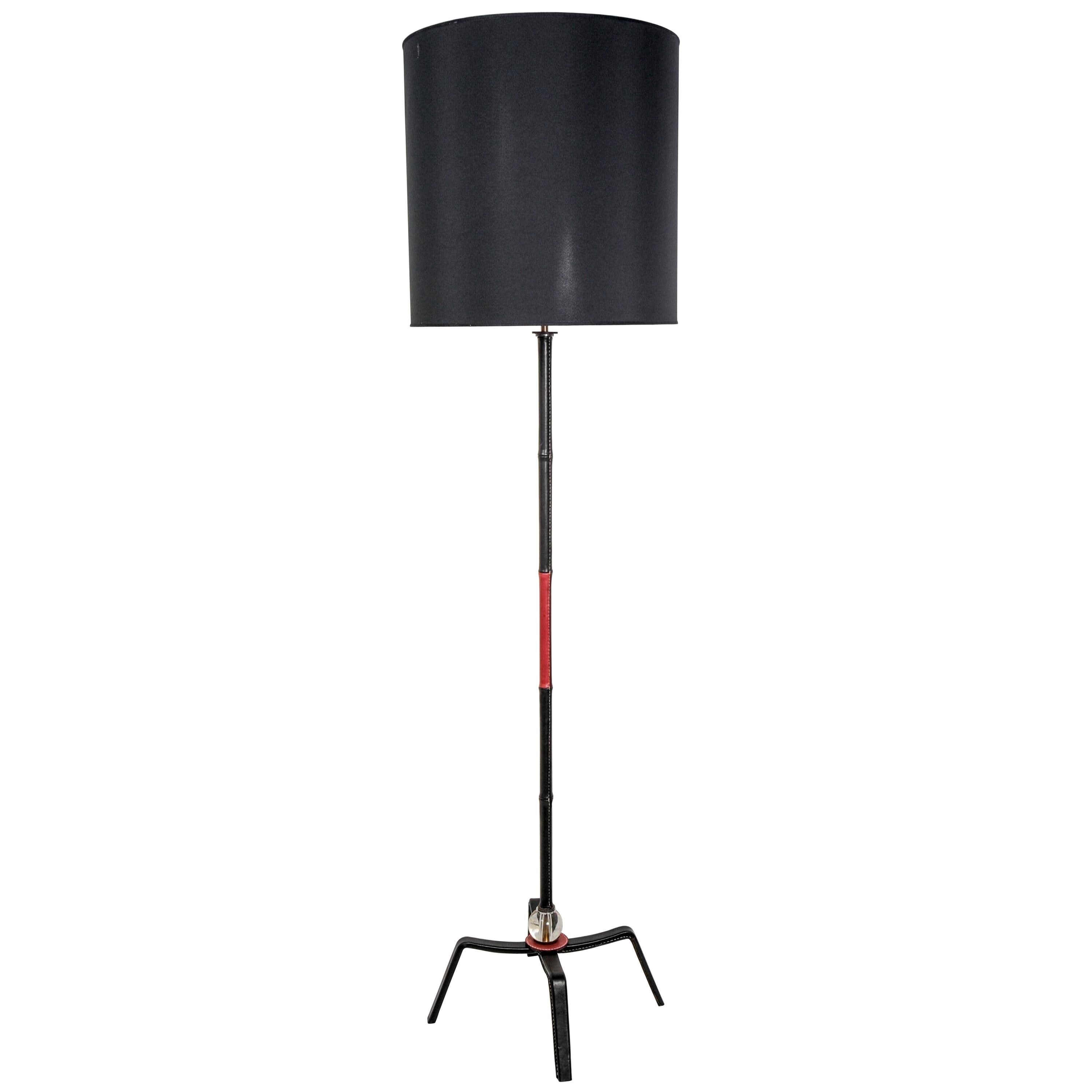 Pair of Stiched Leather Floor Lamps by Jacques Adnet