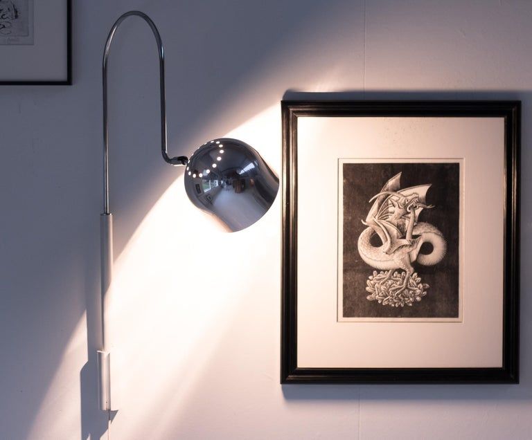 Beautiful pair of adjustable Stilnovo wall lights, in white enameled steel and polished chrome. Very practical lamps for reading or lighting up a piece of art. Marked with Stilnovo Milano label. Priced as a pair.