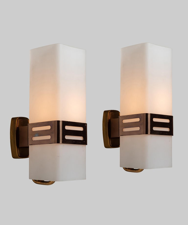 Brass structure with white opaline glass diffuser.