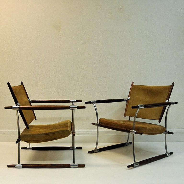 And here comes agreat piece of art! Pair of 'Stokke' chair or `Stick` chair designed by Danish Jens H. Quistgaard (1919-2008) in 1966 manufactured by Nissen,Denmark. Armlayers, backrests, siderests and legs in rosewood, frame of plated steel