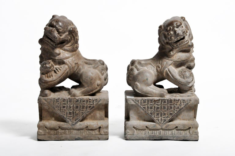 """Often referred to as """"Foo Dogs"""" or """"Fu Dogs"""" in western culture, these handsome stone sentinels are iconic gatekeepers seen throughout Asia. Traditional symbols of protection, they are made from durable materials like bronze or stone and are"""