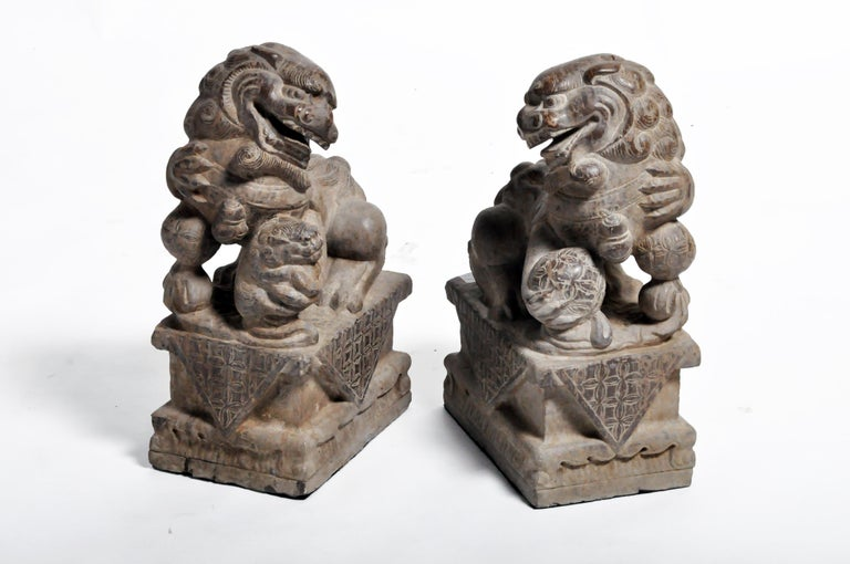 Pair of Stone Carved Fu Dogs on Pedestal For Sale 1