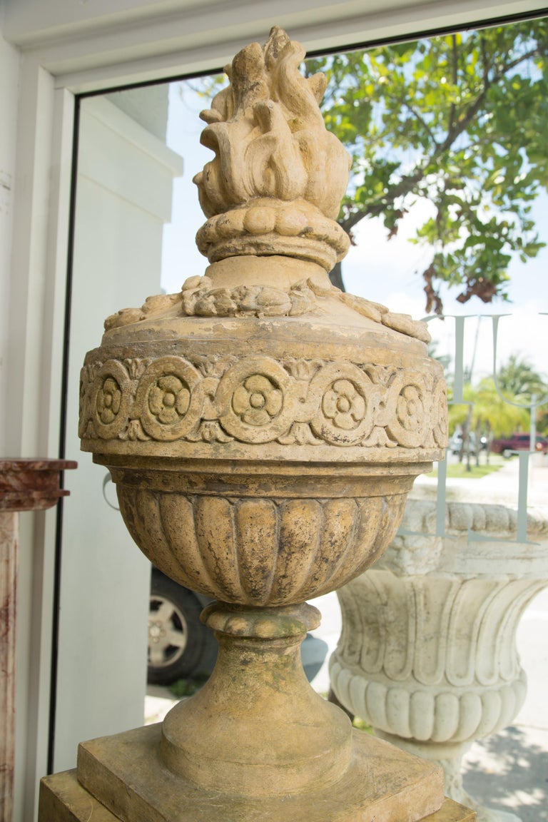 Neoclassical Pair of Stone Cast English Urns on Faux Marble Pedestals For Sale