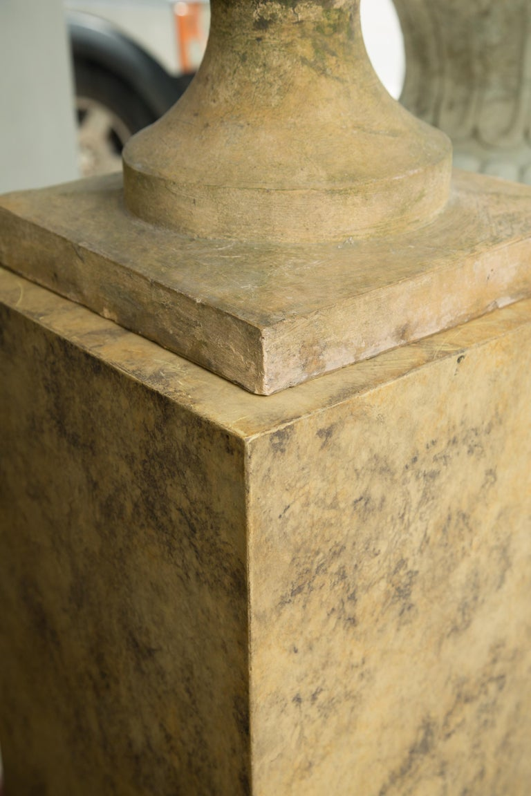 Hand-Crafted Pair of Stone Cast English Urns on Faux Marble Pedestals For Sale