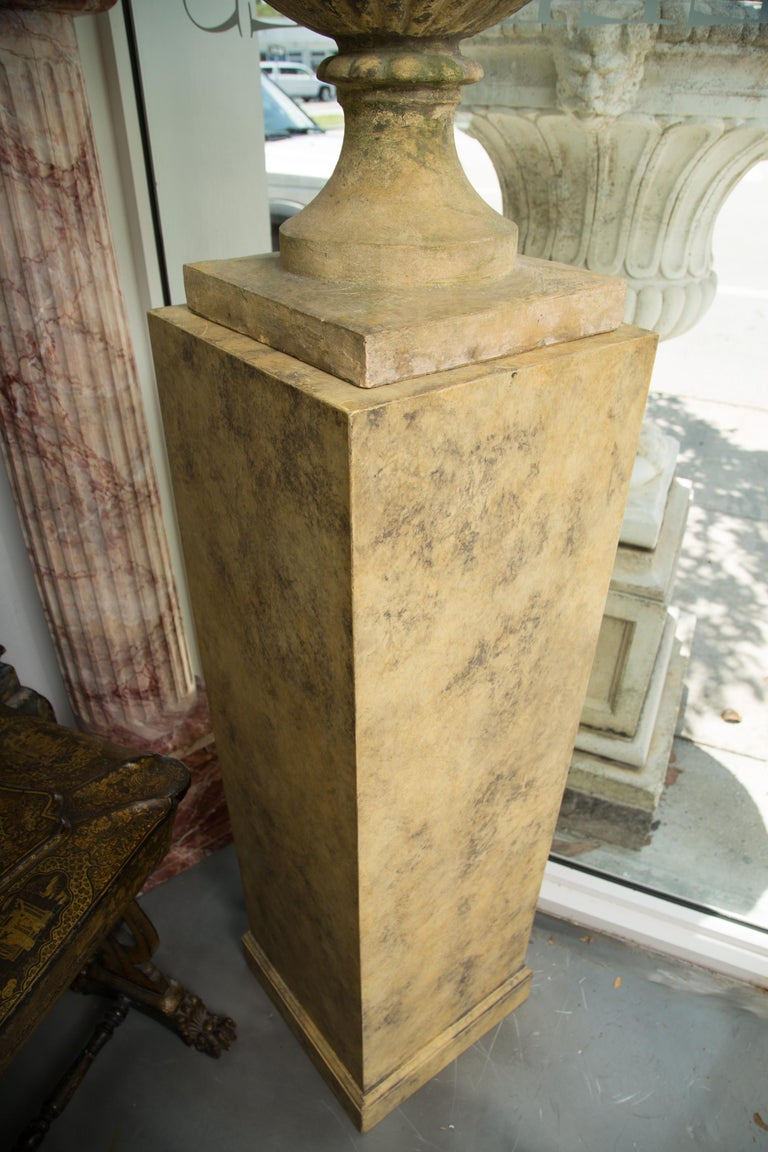 Pair of Stone Cast English Urns on Faux Marble Pedestals In Good Condition For Sale In WEST PALM BEACH, FL