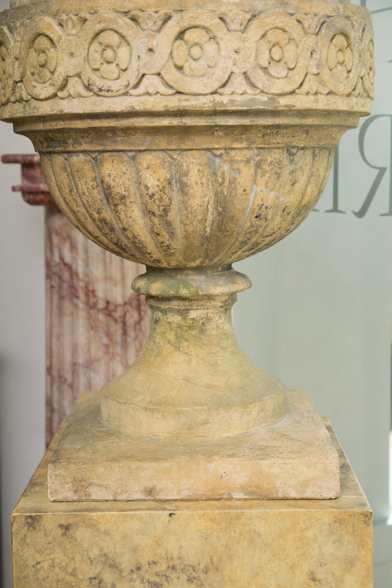 20th Century Pair of Stone Cast English Urns on Faux Marble Pedestals For Sale