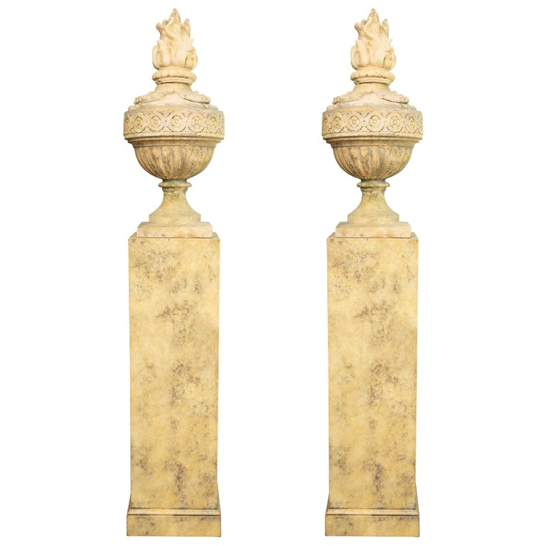 Pair of Stone Cast English Urns on Faux Marble Pedestals For Sale