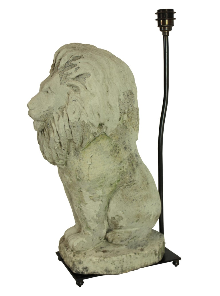 A pair of reconstituted stone lions as lamps with bronze fittings. Note these are very heavy.