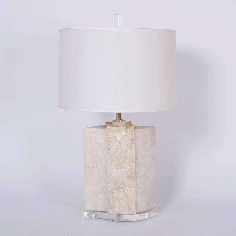 Chic midcentury pair of table lamps crafted in blocks of stone both polished and natural. Featuring Lucite finials, stems, and bases.