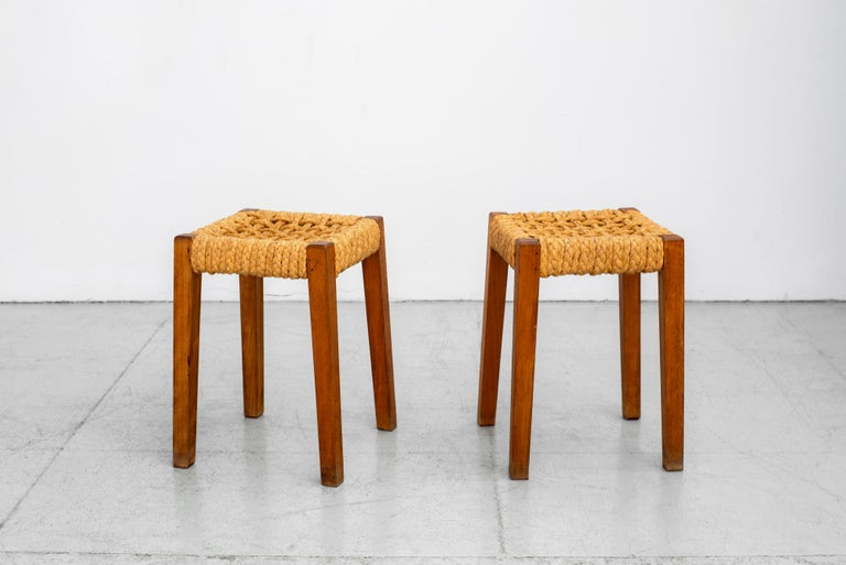 Wonderful pair of stools by Audoux Minet rope seat with oakwood legs, France, circa 1940s.