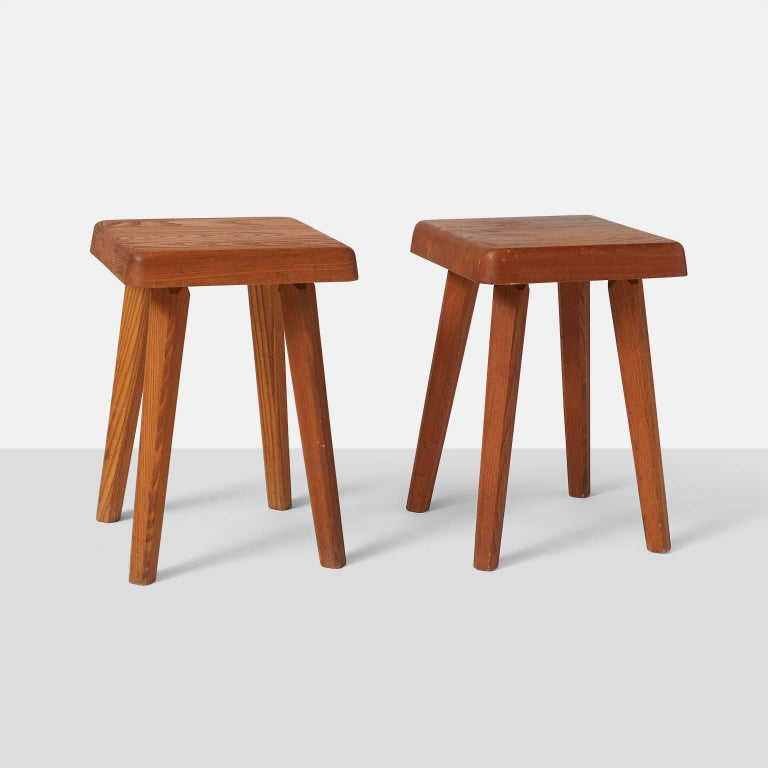 A pair of Pierre Chapo model S01A stools with a square seating. These pieces in the Campagne style are made of a rich dark and warm elm, France, circa 1960s.