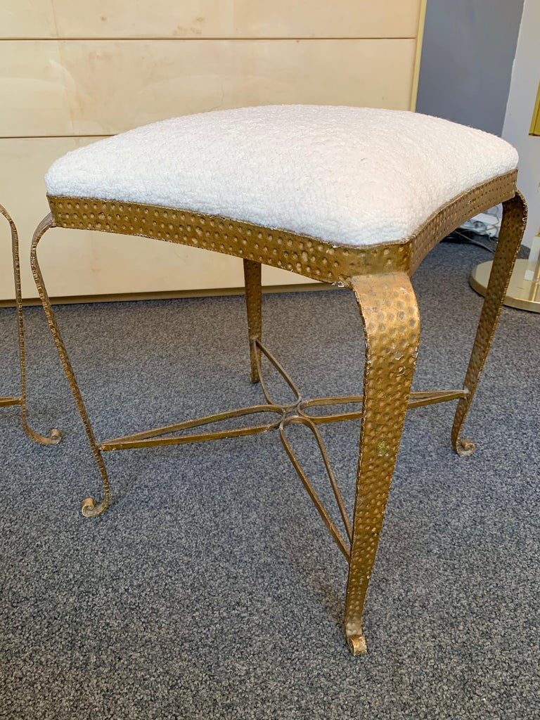 Pair of stools, poufs or ottomans by Pier Luigi Colli. Hammered wrought iron and gold leaf. Fully upholstered in bouclé fabric. A bench are available on my storefront. Famous design like Maison Jansen, Baguès, Gilbert Poillerat, Raymond Subes,