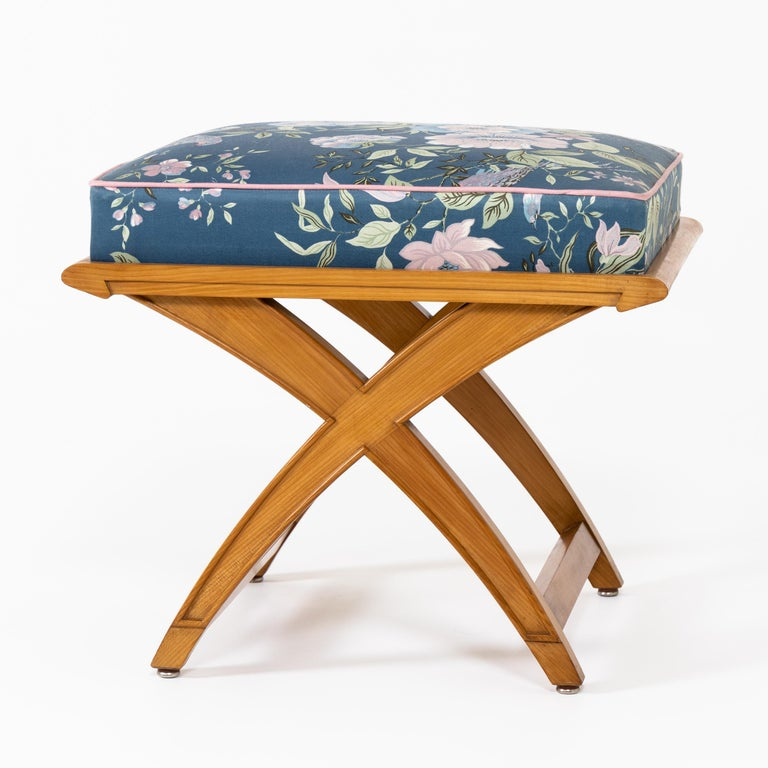 Pair of stools on X-shaped frame with rectangular seat. Very beautiful design of the strutting.