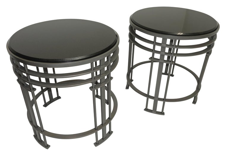 A pair of midcentury side tables, having bead blasted steel bases and a beveled black granite top. American, 1930s-1940s. In excellent condition.