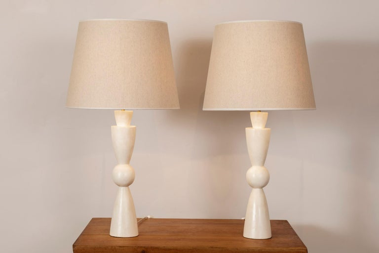 A pair of stuccoed plaster lamps. In the manner of Jean-Michel Frank. France, contemporary creation.  Dimensions:  Height total 80 cm (31.5 inches) Height plaster foot 46 cm (18.1 inches) Diameter 42 cm. (16.5 inches).