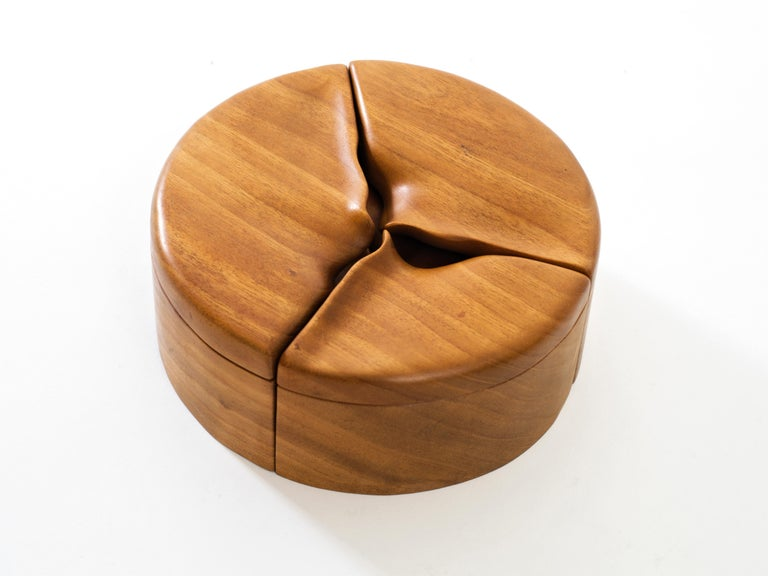 An alluring pair of handmade nesting boxes in contrasting finishes and with sensually carved lids, each separating into smaller components perfect for storing small objects such as jewelry. Beautifully crafted and tactile desktop or tabletop