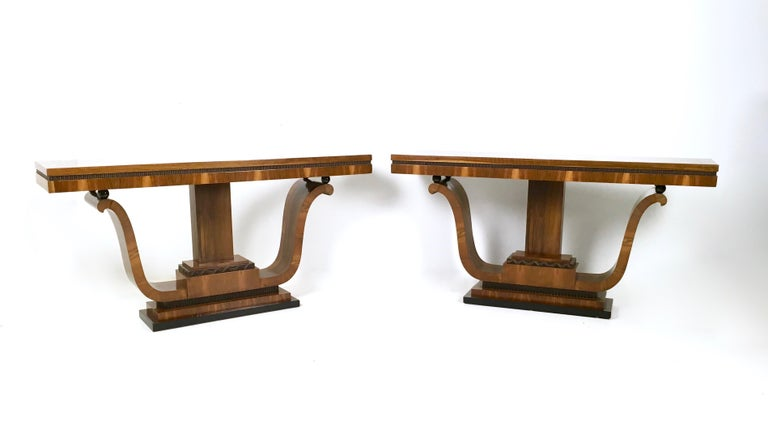 They are made in walnut and feature ebonized wood parts. These two beautiful consoles have been perfectly restored and polished with shellac.  They might show slight traces of use since they are vintage, but they can be considered as in perfect