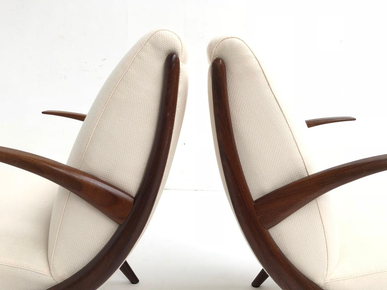 A stunning pair of Scandinavian teak armchairs from the late 1950s Beautiful organic design in carved solid teak wood This set has been newly upholstered with new Pantera Foam and a wool and linen De Ploeg fabric An older restoration to one of
