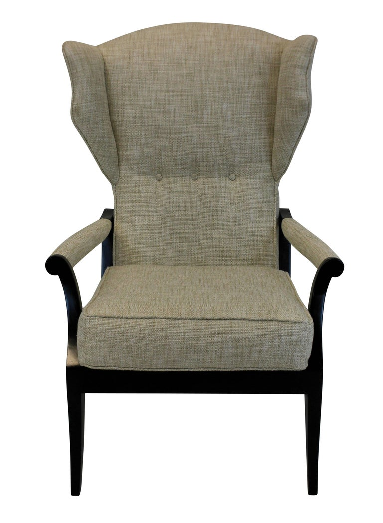 A pair of Italian reclining armchairs of stylish design. In ebonized wood and upholstered in oatmeal twill.