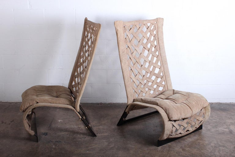 A pair of suede lounge chairs deigned by Mario Cecchi. Suede with enameled frames and brass hardware.
