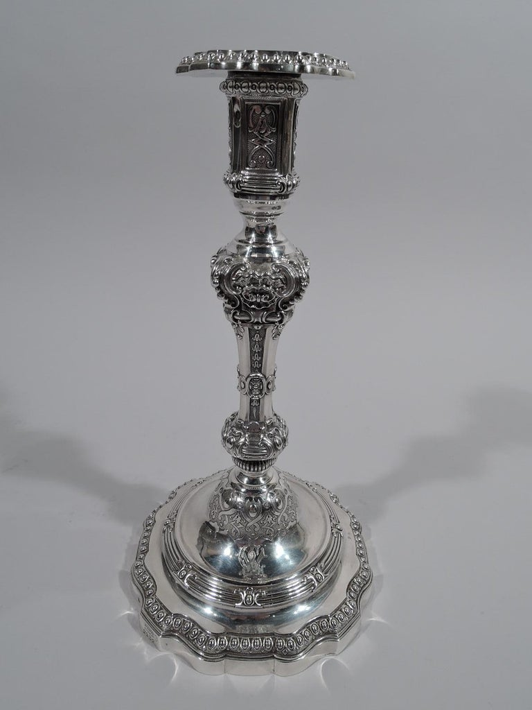 Pair of super sumptuous 950 silver candlesticks. Made by Odiot in Paris, circa 1860. Each: Knopped shaft on double-domed foot with curvilinear rim; tall and straight socket with detachable bobeche. Dense and chased Classical ornament with scrolls,