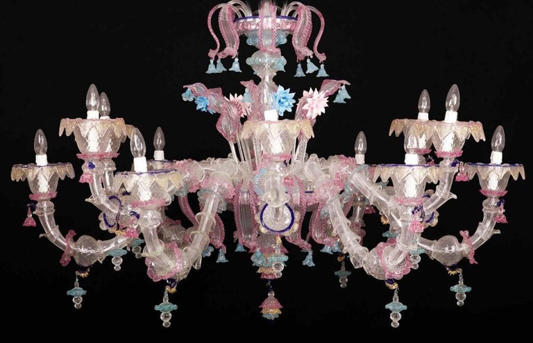 Beautiful Murano chandelier with 18 arms and a multitude of pink and heavenly flowers in glass paste and gold inclusion, creating a magic light effect. Available also a pair. 18 E14 light bulbs. We can wire for your country standards.