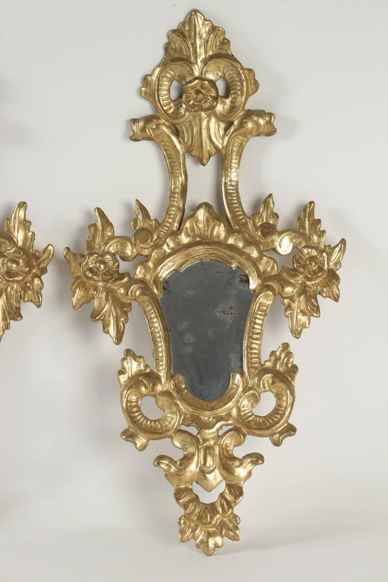 Pair of superior quality gold gilt wooden hand-carved mirrors Napoleon III.   h: 73cm, l: 40cm, p: 15cm .