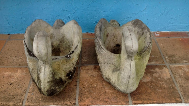 Substantial and dramatic form cast as figures of swans. The planters have a good and earthy patina. (A second pair is also available). Price shown is for one pair only.