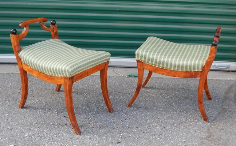 Pair of Swedish Biedermeier revival benches or stools. Rendered in golden birch wood with ebonized birch details. In original condition with no instability. In original fabric. Ready for a lifetime of good use, Sweden, circa 1920.
