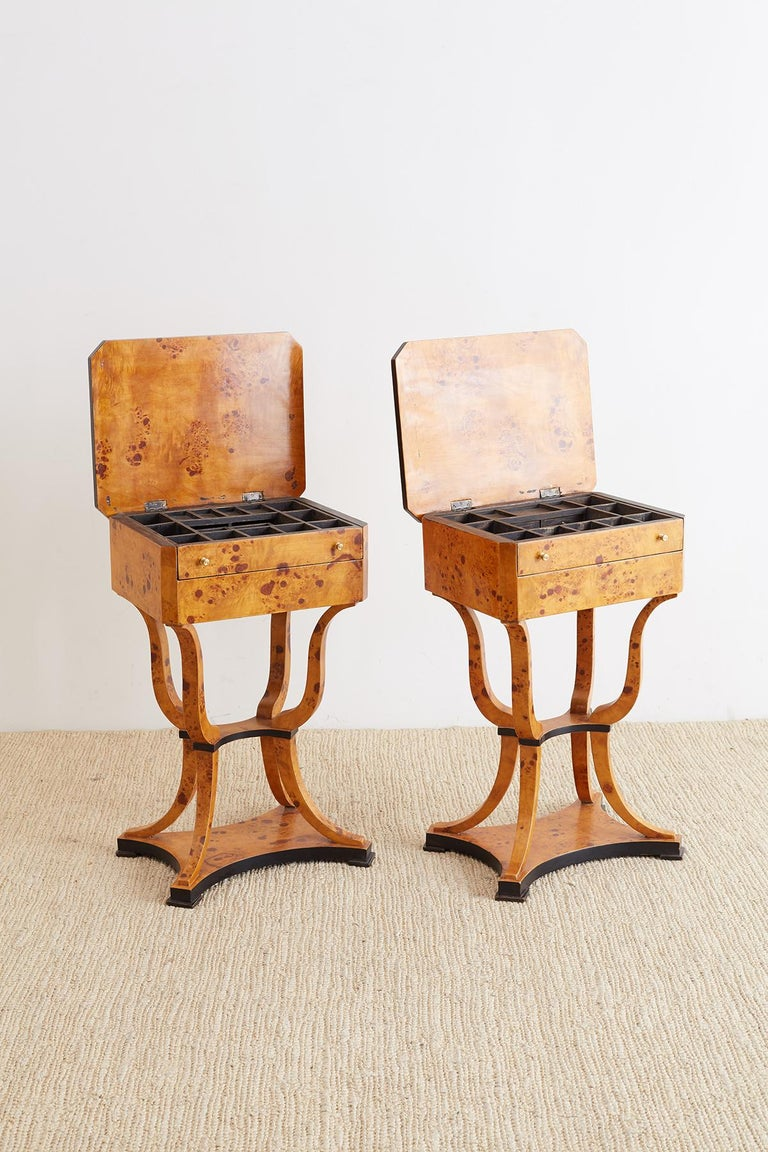 Elegant pair of Swedish sewing tables made in the Biedermeier style of birch and maple burl wood. Distinctive flip top style opens to a removable fitted drawer. The case has beveled edges and a drawer on the side. Beautifully constructed from burl