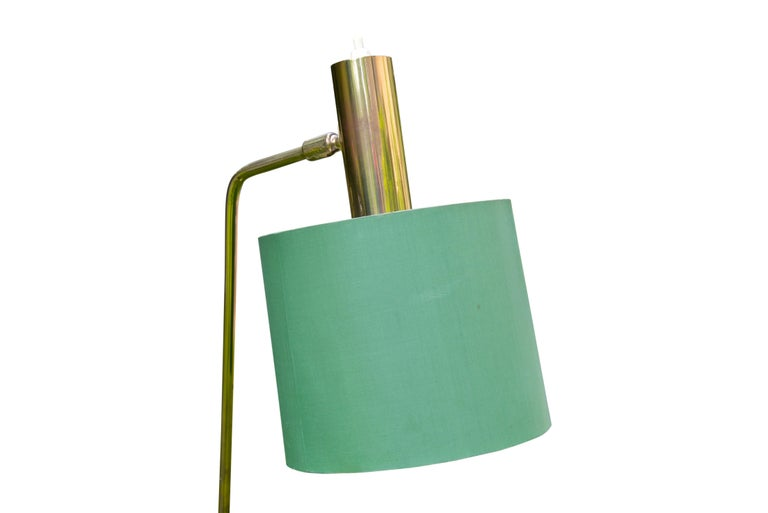 Pair of Swedish floor lamps in brass with original green shades made by the Bergbom AB Company, circa 1960-1969.