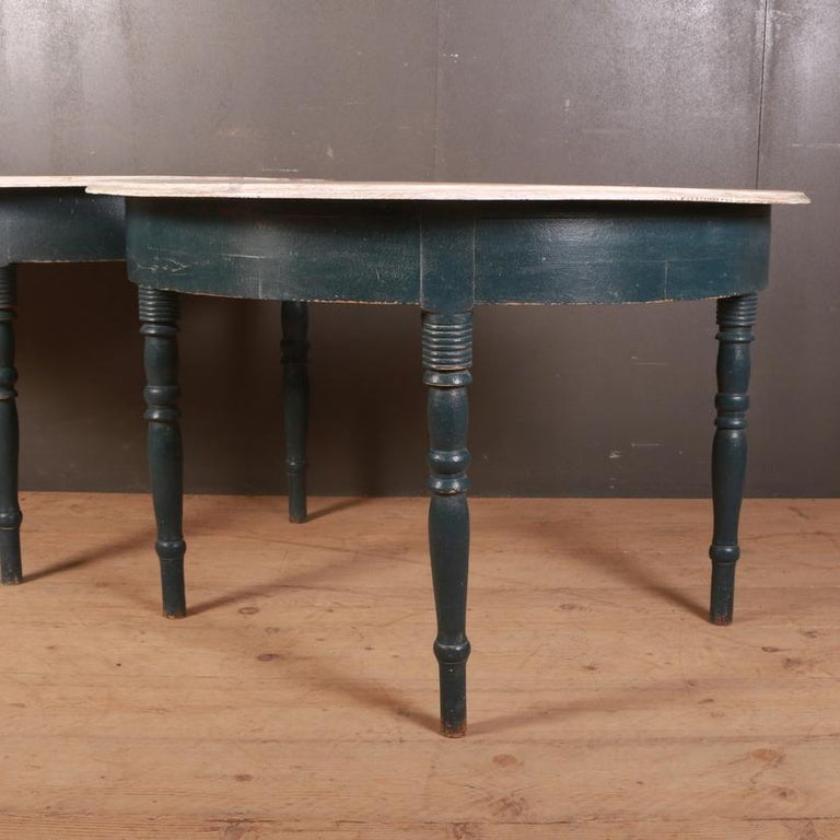 Pair of 19th century Swedish demilune console tables. These can also be put together to make a circular dining table. 1850  Dimensions 46 inches (117 cms) wide 23 inches (58 cms) deep 30 inches (76 cms) high.