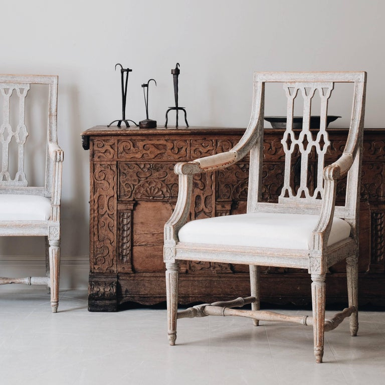 Pair of fine 18th century Gustavian armchairs in original color and a very unusual back splat. Marked with the seal of Stockholm chair maker's guild, circa 1790, Stockholm Sweden.