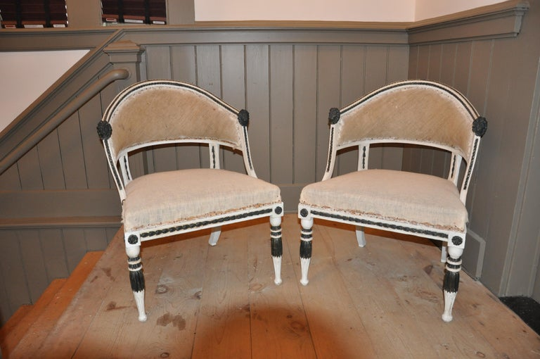 Pair of Swedish neoclassical chairs attributed to Ephraim Stahl. Of typical Gustavian form with lion head arm ends and sweeping curved back. In very good structural condition. Early paint.