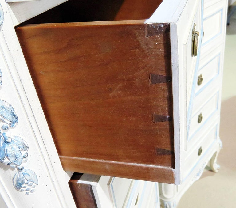 Pair of Swedish Louis XVI style six-drawer lingerie chests with distressed paint and glass tops.