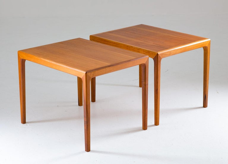 A pair of midcentury side tables in walnut by Bertil Fridhagen for Bodafors, Sweden. These high-quality side tables have a minimalistic design with distinct lines. Condition: Good original condition. A few ring marks on one of the tables and one