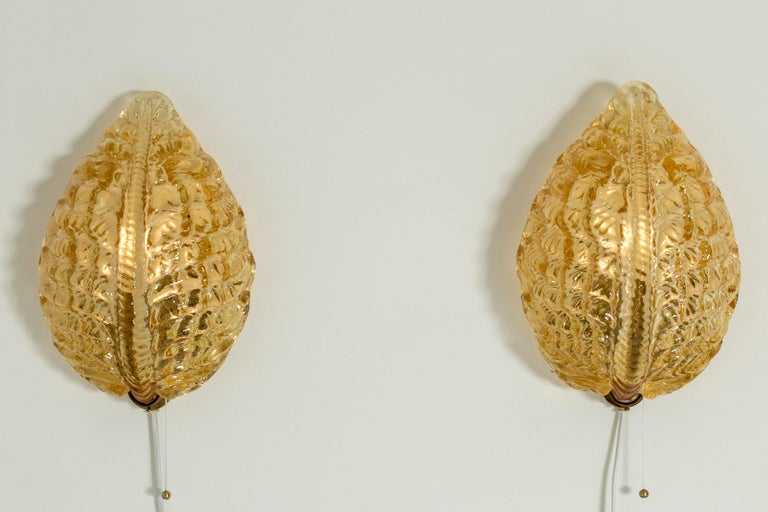 Mid-20th Century Pair of Swedish Modern Glass Wall Lamps from Orrefors For Sale