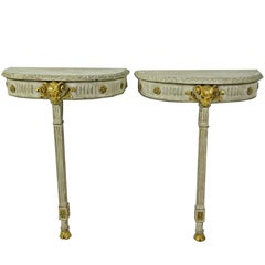 Pair of Swedish Neoclassic Cream Painted and Gilt Demilune Console Tables