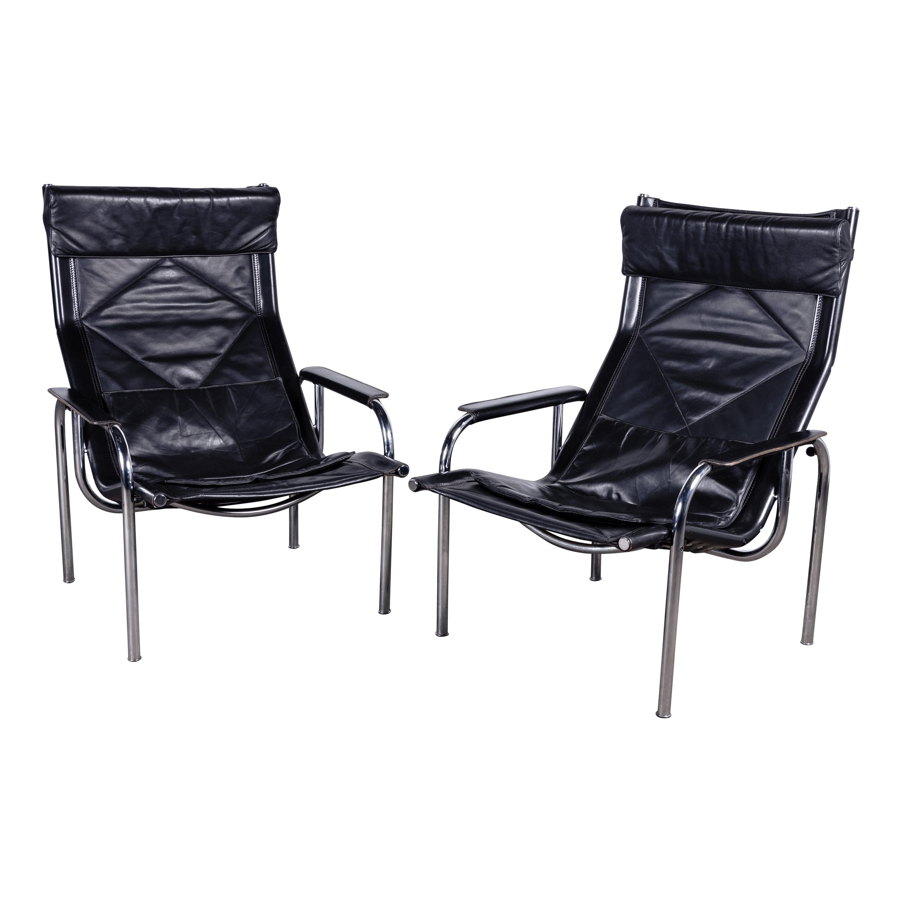 Pair of Swiss Reclining Black Leather and Chrome Strässle Chairs by Eichenberger