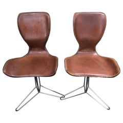Pair of Swivel Chairs in the style of Arne Jacobsen