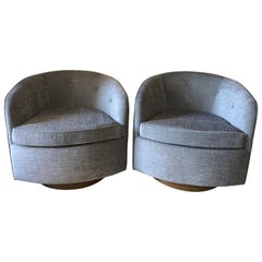 Pair of Swivel Lounge Chairs on Walnut Base