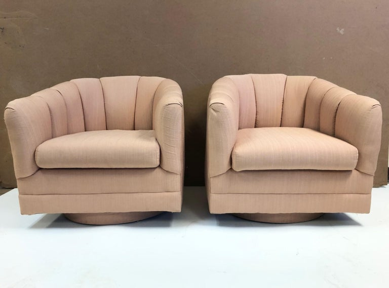 Pair of swivel lounge chairs style of Milo Baughman. Original upholstery.