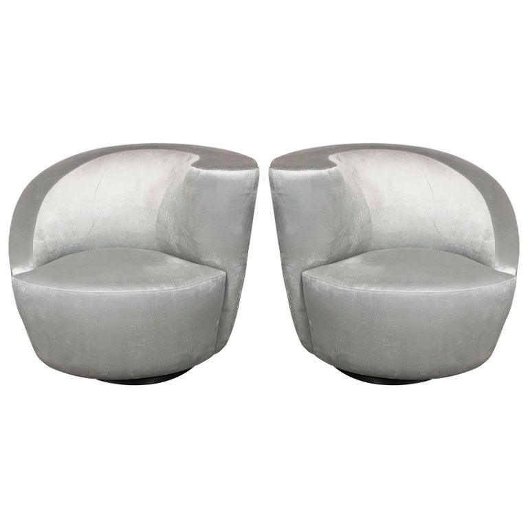 This pair of Nautilus chairs exemplify the stunning organic futurist forms and clean lines for which Vladimir Kagan one of the most esteemed furniture designers of the 20th century is celebrated. The chairs' form suggests an abstracted