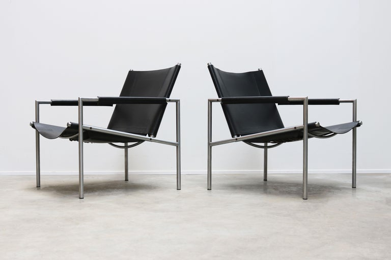 Magnificent pair of SZ01 Minimalist lounge chairs in black leather and chrome by Dutch Industrial designer: Martin Visser for T' Spectrum in 1960. The Minimalist tubular chrome frame in combination with the leather armrests and leather back/seat